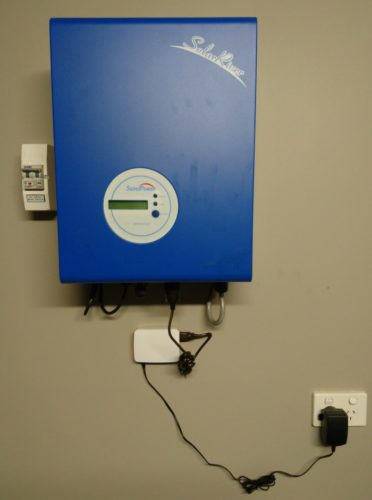 Our inverter (blue box) with the Raspberry Pi attached (the little white box).